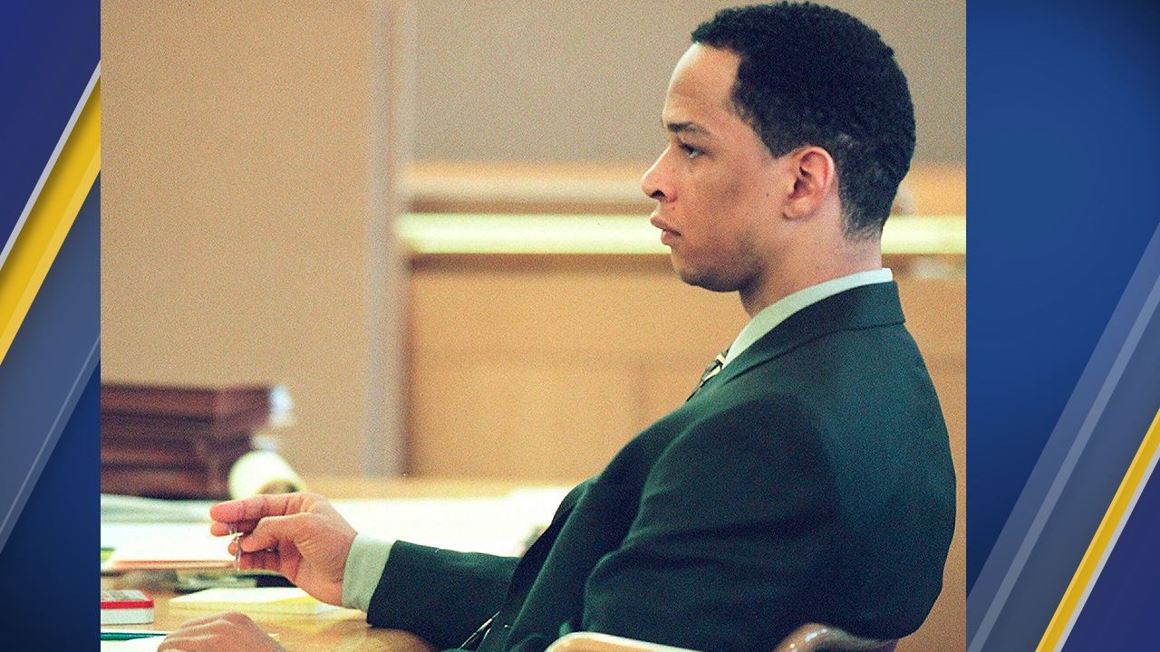 FILE - In this Jan. 3, 2001, file photo, former Carolina Panthers NFL football player Rae Carruth sits at the defense table during his trial in Charlotte, N.C.