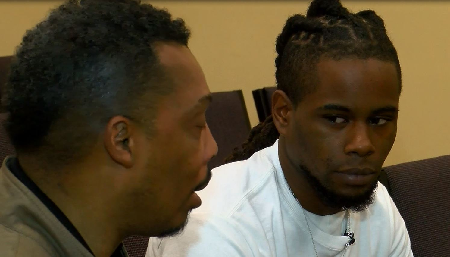Deandre Bramlett sitting with Pastor Henry Lavender. (Source: WMC)