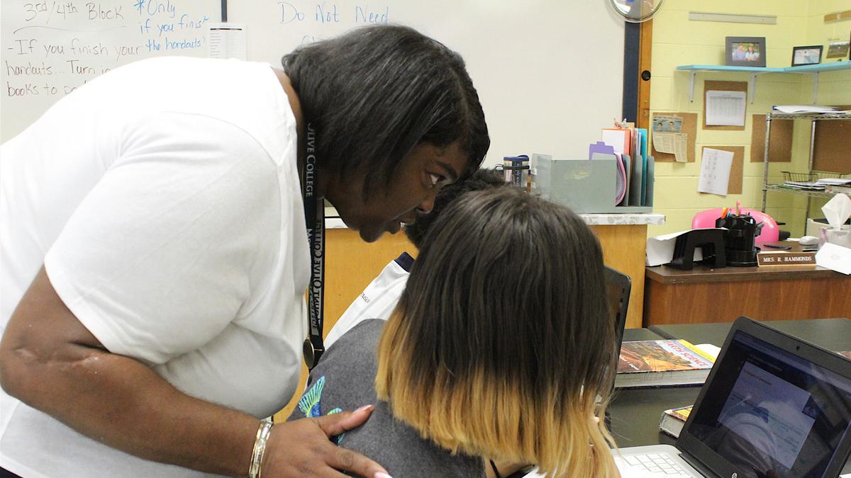 Pamela Eatmon helping students (Source: Wilson Times)