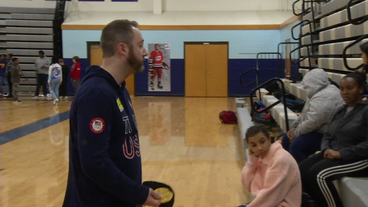 Tyler George brought his gold medal along for the visit as he helps promote curling.