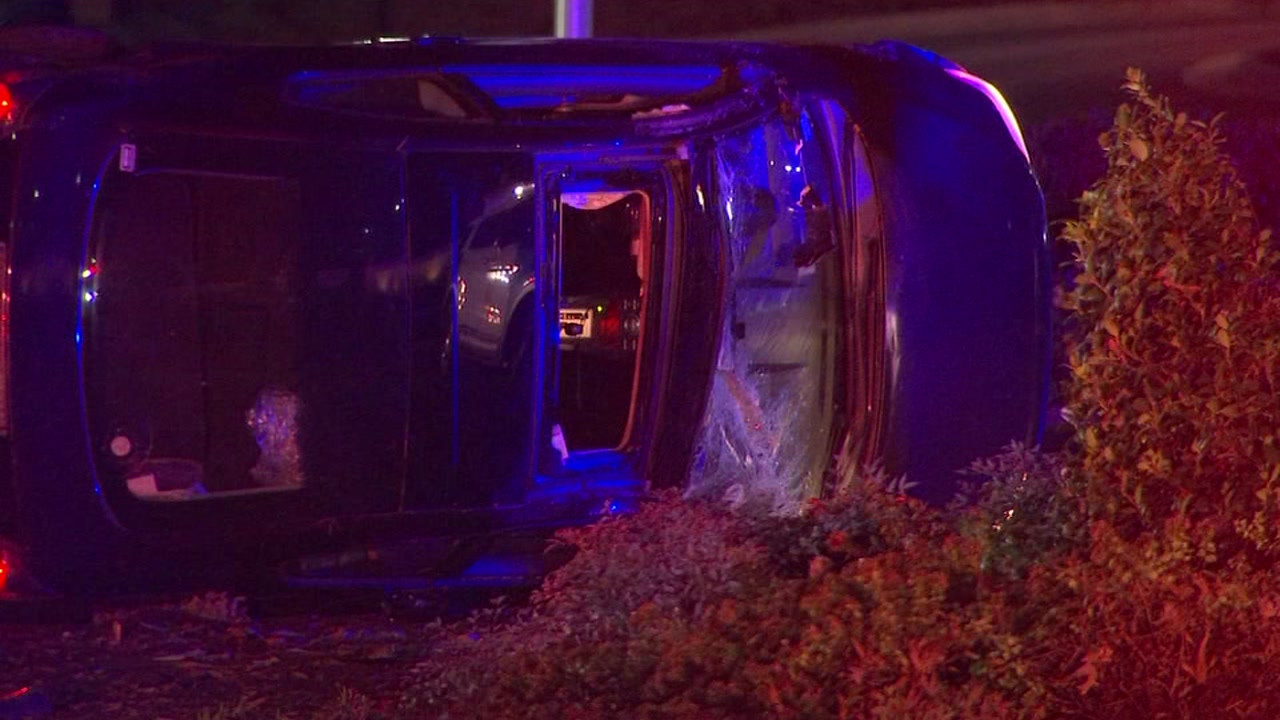 A woman was rushed to the hospital after police said her car jumped a curb and flipped over.