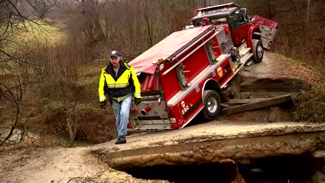 Firetruck gets stuck in creek on way to house fire in Buncombe County
