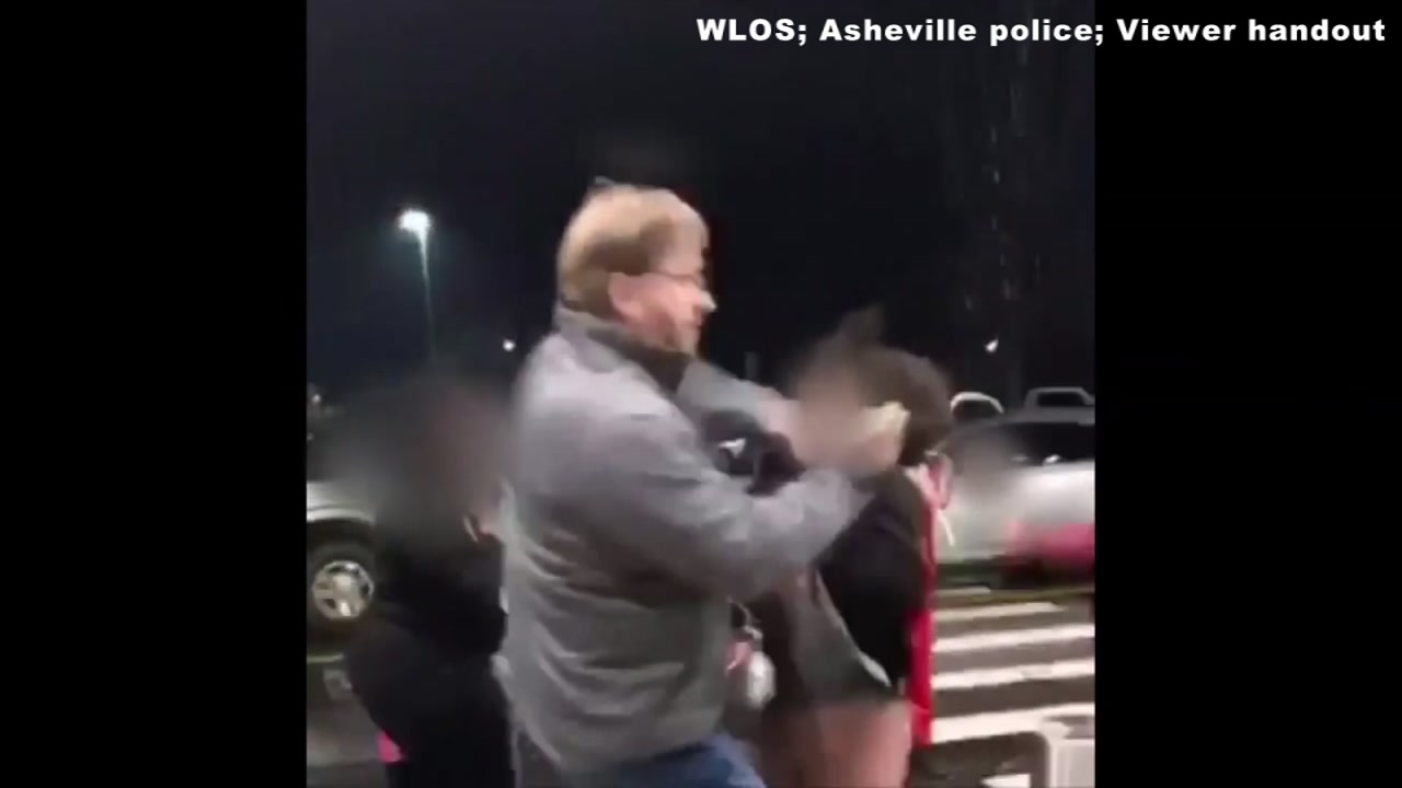 Police are investigating after a 51-year-old man was caught on camera pushing and punching a girl in the face outside of Asheville Mall.