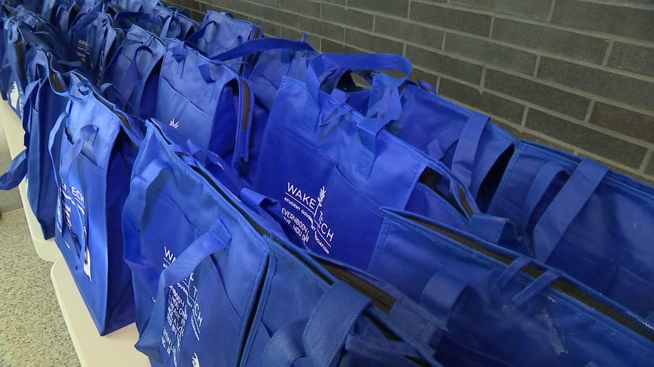 Students at Wake Tech took two hours out of their morning to stuff bags with food for other students.