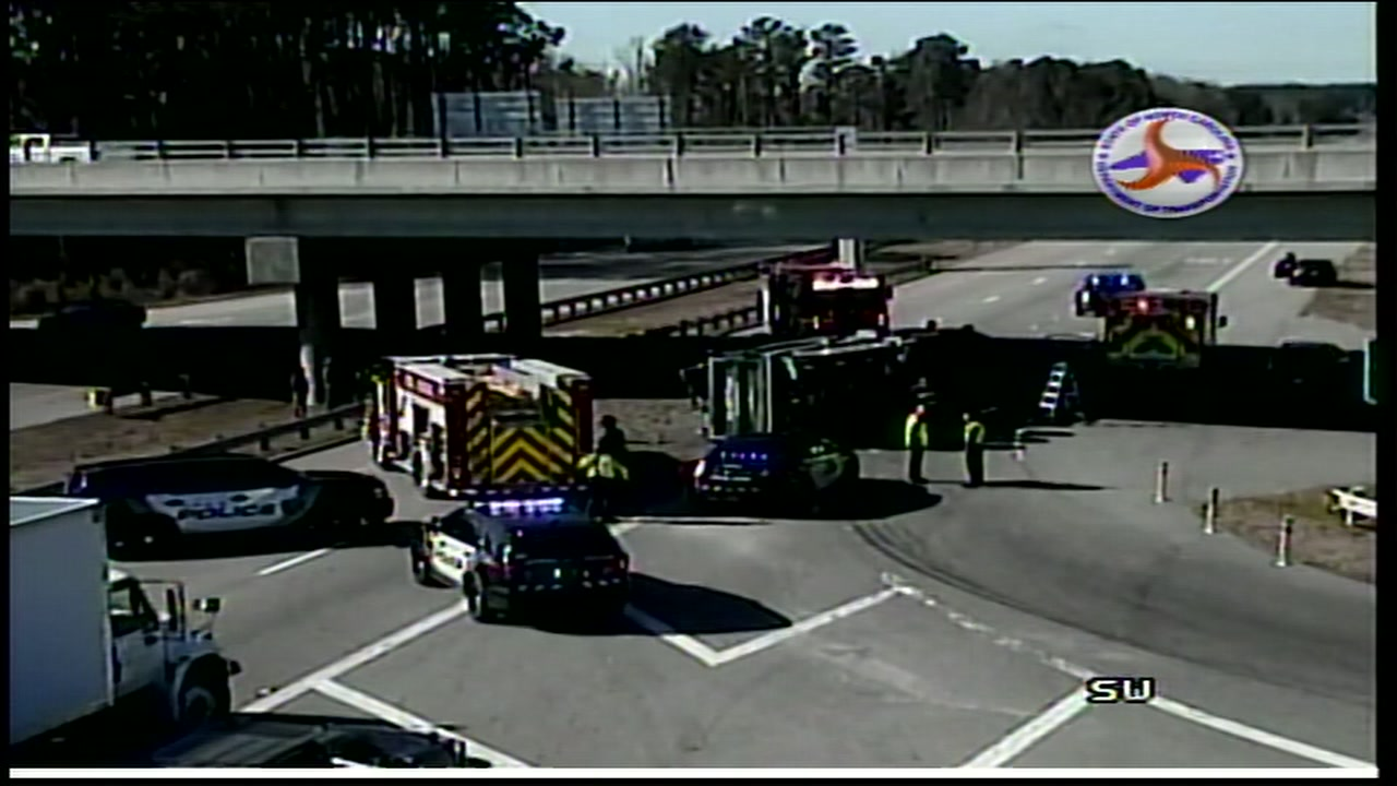 An overturned dump truck has closed US-64 westbound near Kelly Road in Apex.