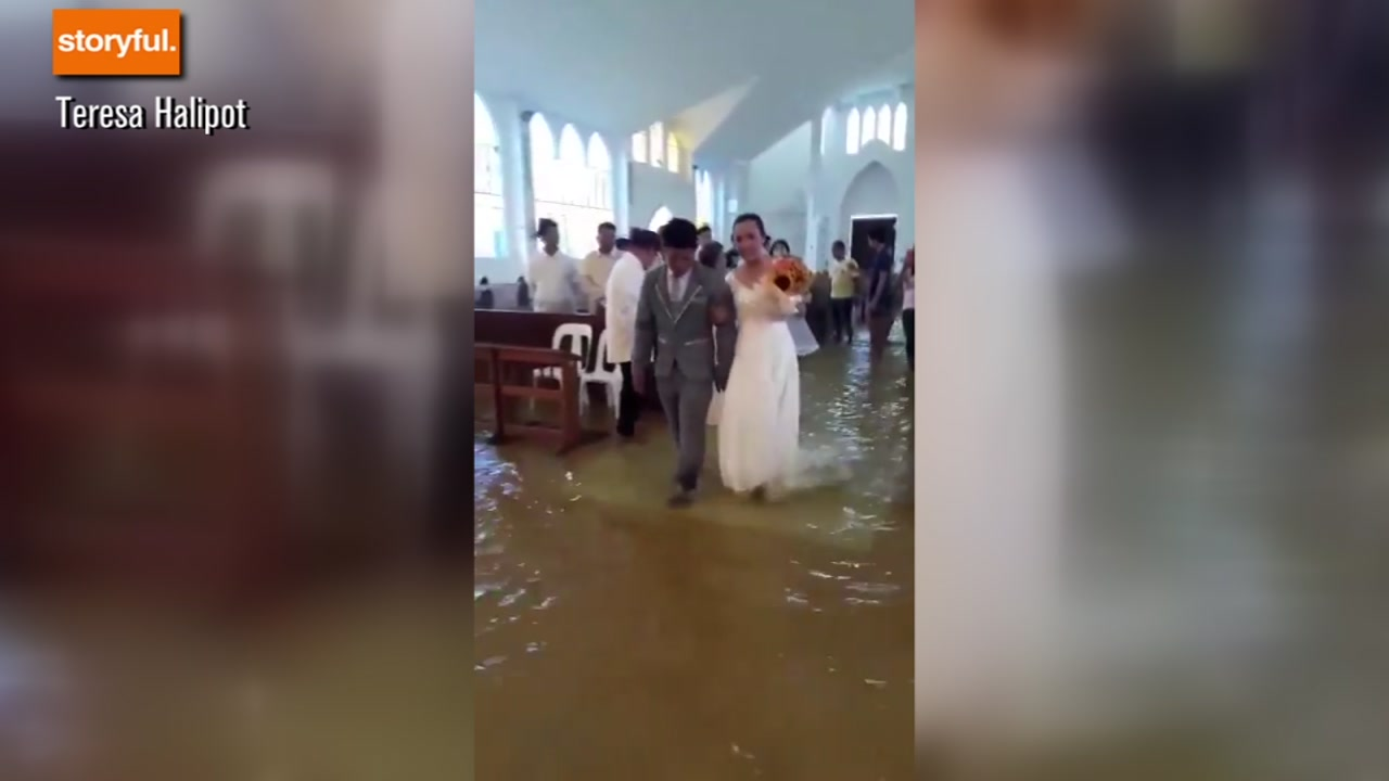 Bride doesnt let flooding get in the way of her wedding day