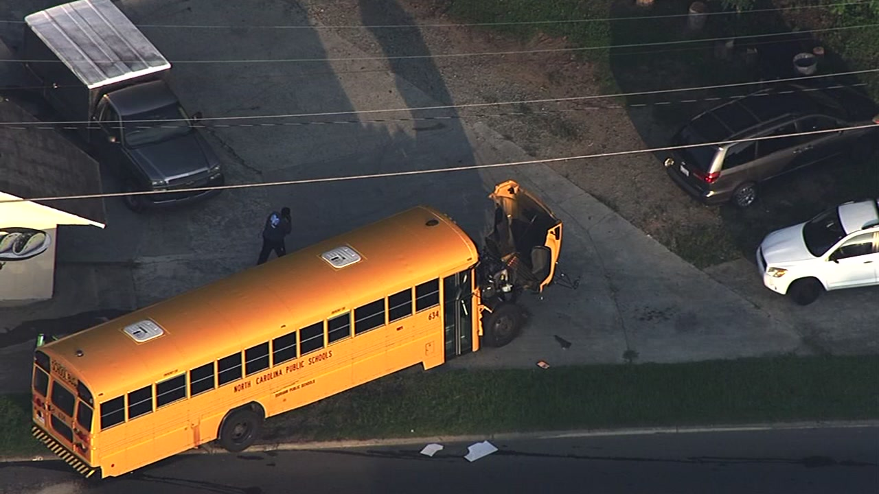 A man was arrested Friday morning after a multi-vehicle crash involving a school bus from Durham Public Schools.