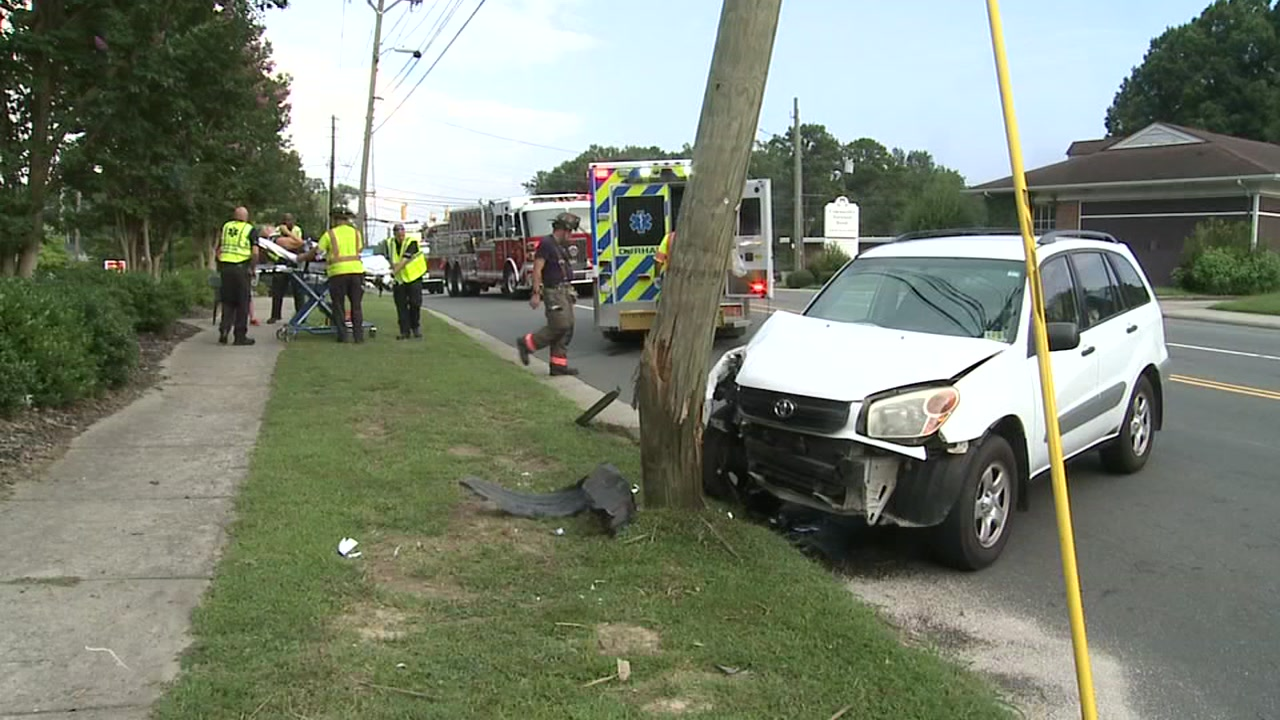 Part of Guess Road closed after a car hit a power pole Monday.