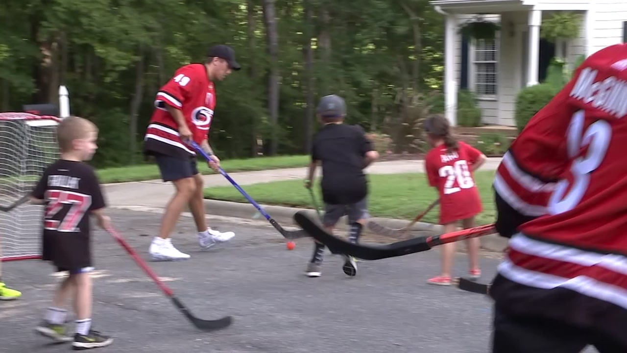 Hurricanes players deliver season tickets