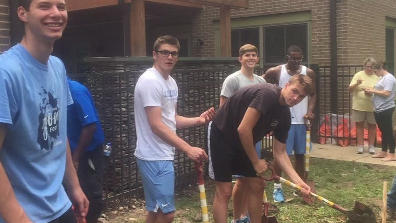 The UNC swim team helped out at Ronald McDonald house ahead of Florence.