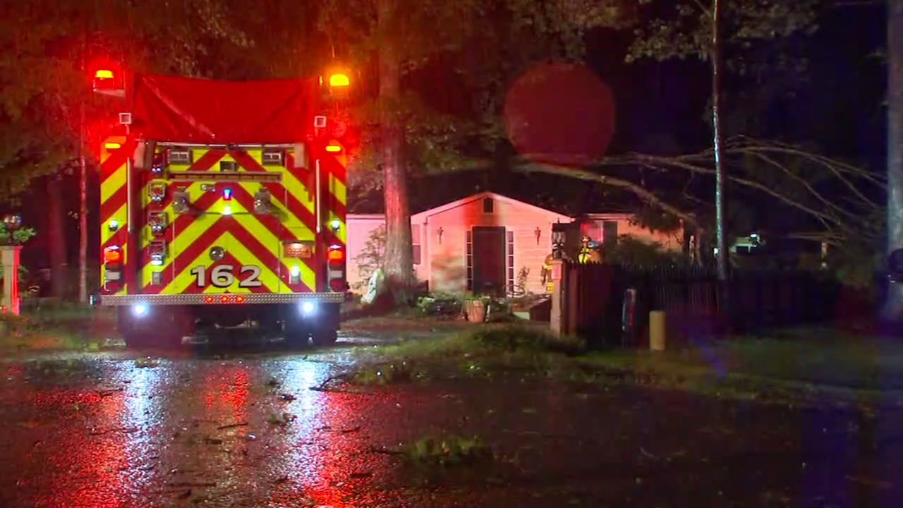 A tree fell on a north Raleigh home Friday night while five people slept inside.