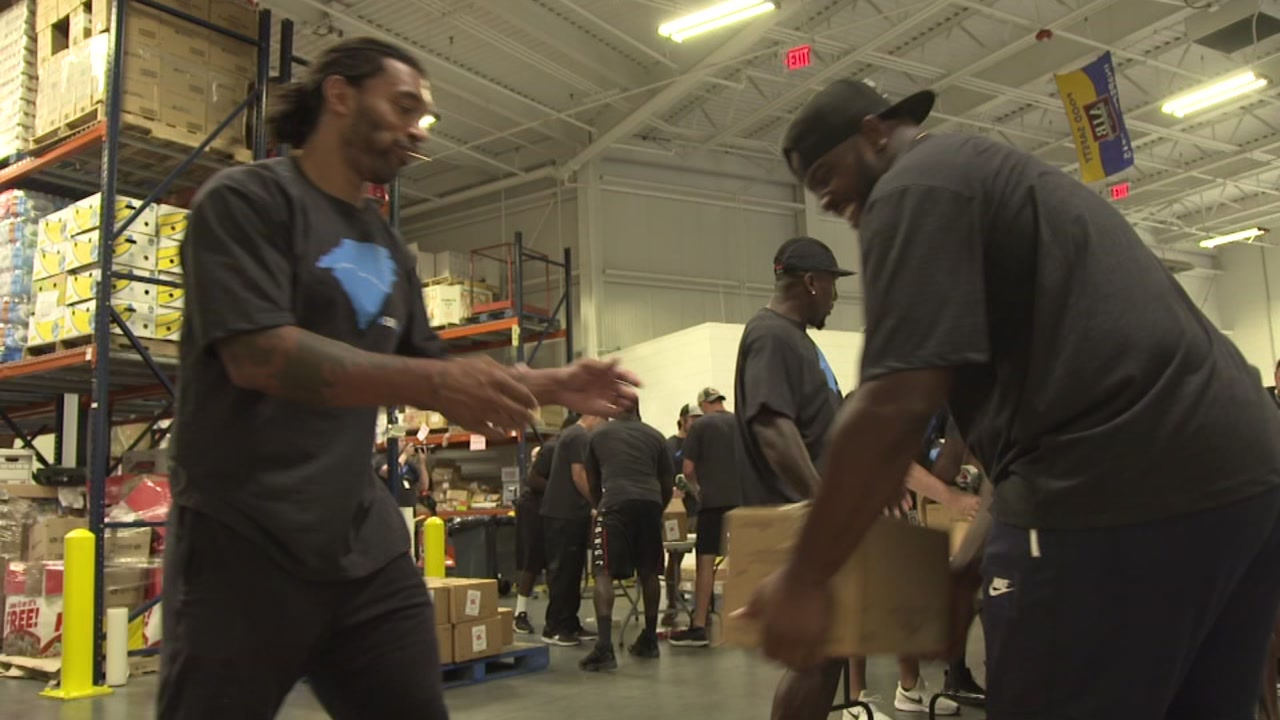 Carolina Panthers pack boxes for Hurricane Florence victims