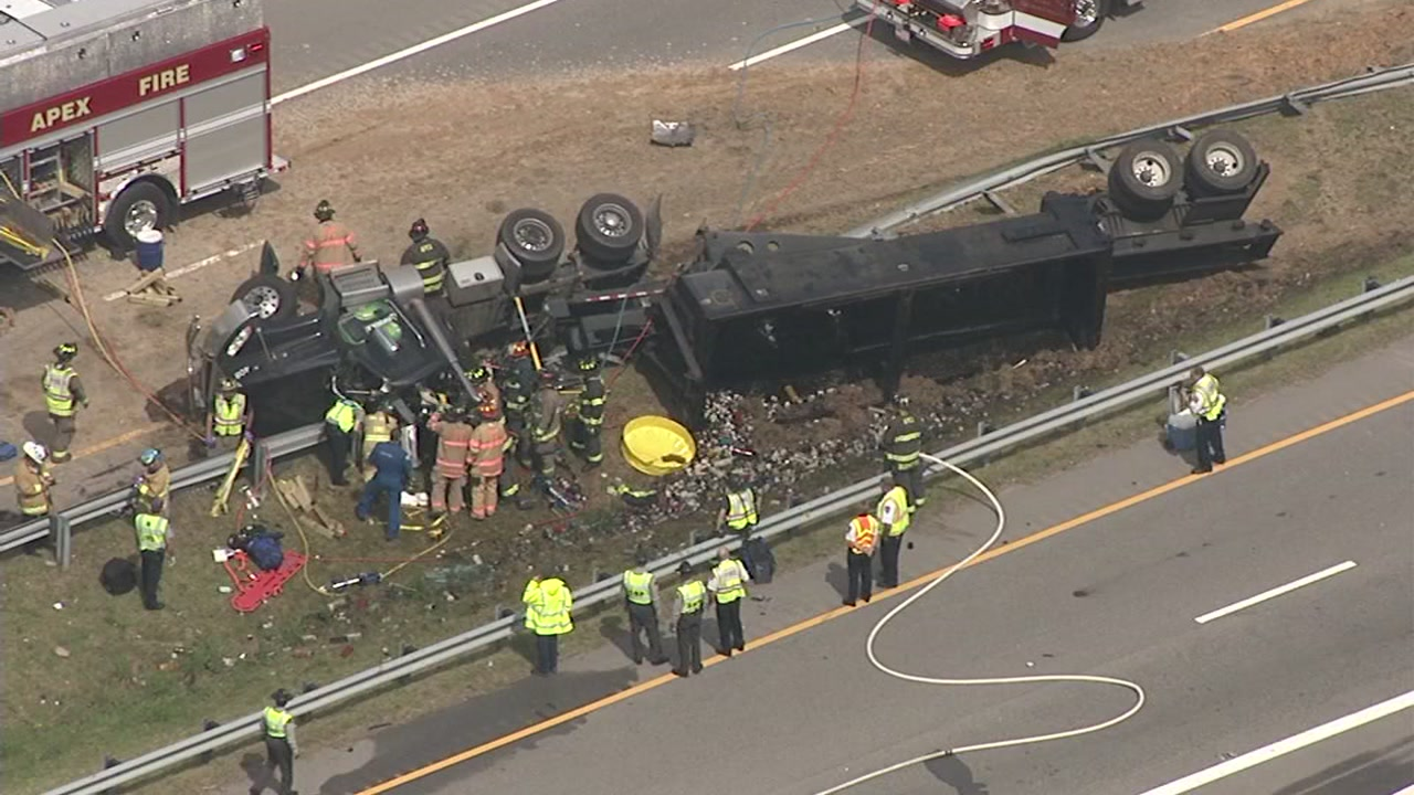 An overturned tractor-trailer has closed the southbound lanes on US 1 in Apex.