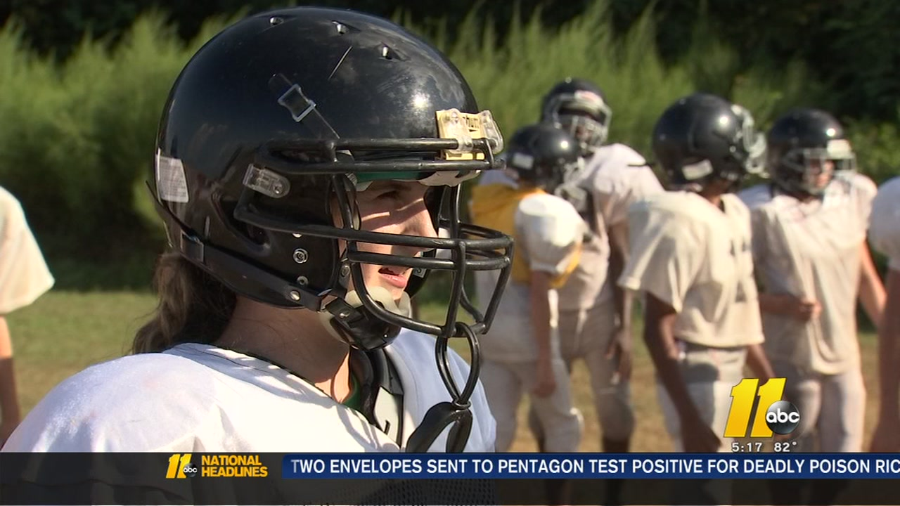 Julia Napoli, an eighth-grader at Grays Creek Middle School, is making history as the first girl to make the football team.