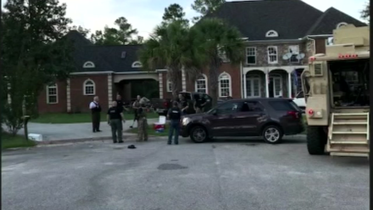 Officials say 74-year-old shot South Carolina officers serving warrant on another man