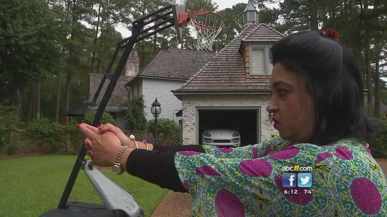 Woman says robber held a gun to her head