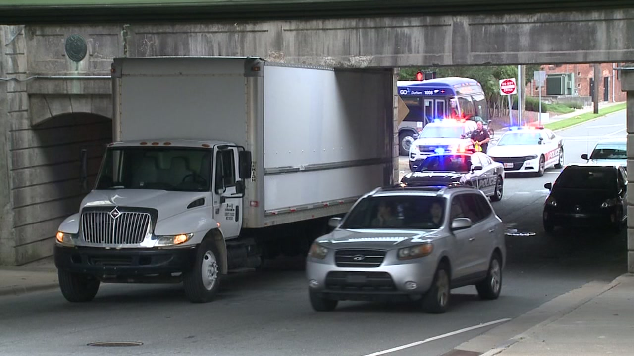 The infamous Roxboro Street bridge in Durham claims another truck that thought it could squeeze through.