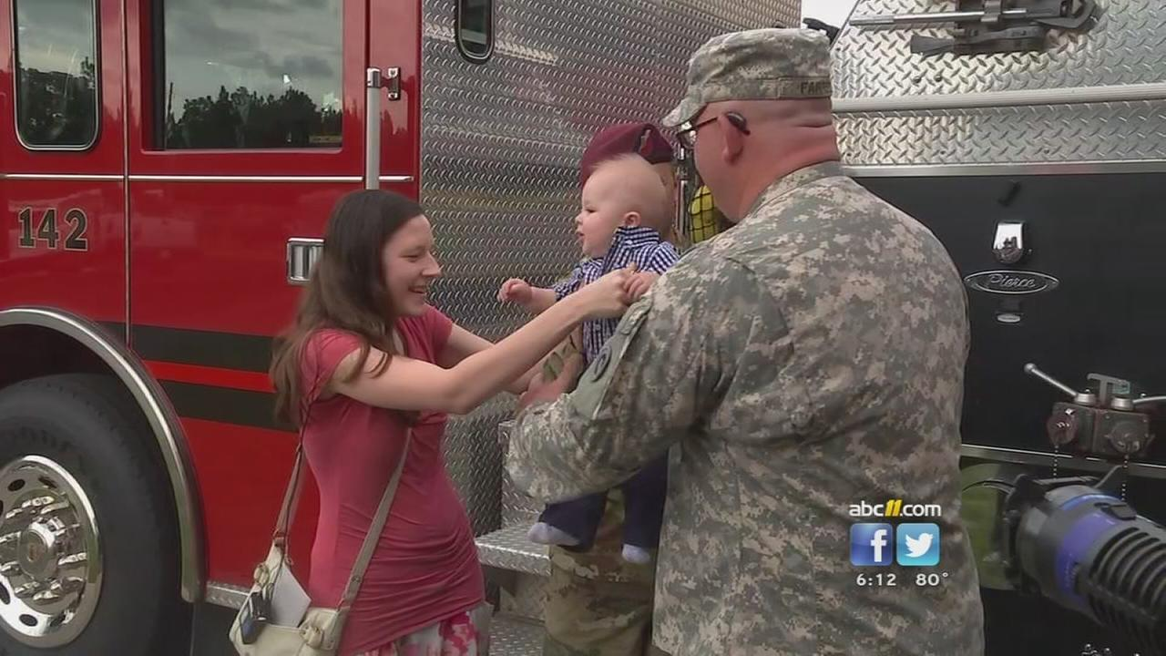 Soldier meets baby he saved