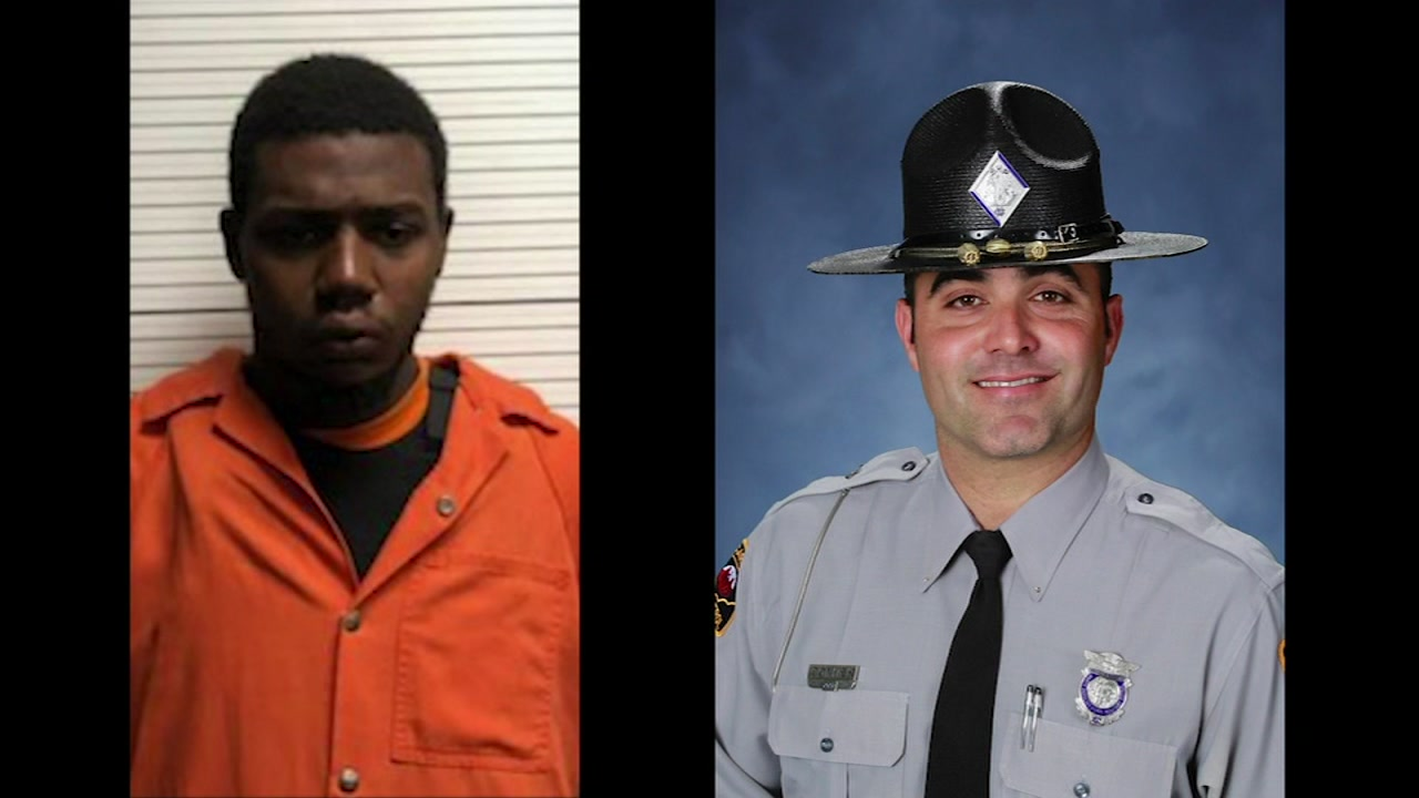 Raheem Davis, left, and trooper Kevin Conner
