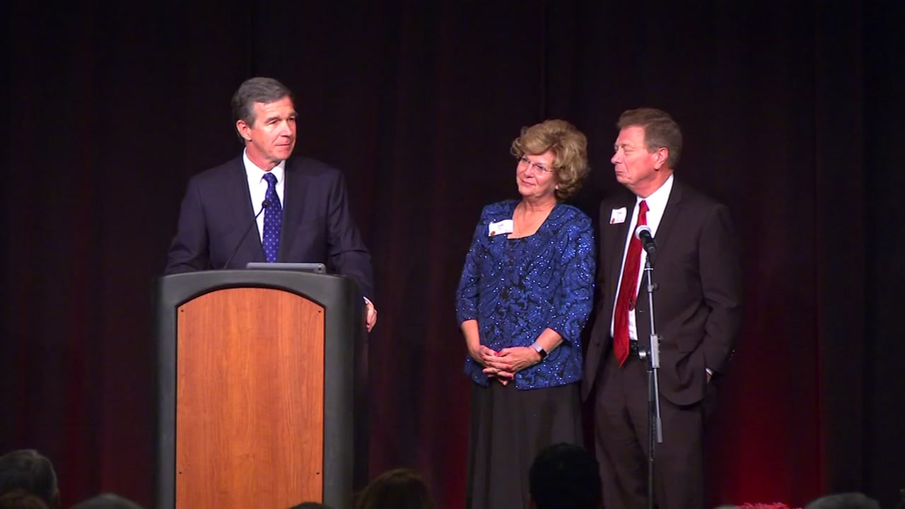 Gov. Cooper gives the states highest honor to Durham Rescue Mission founders Ernie and Gail Mills.