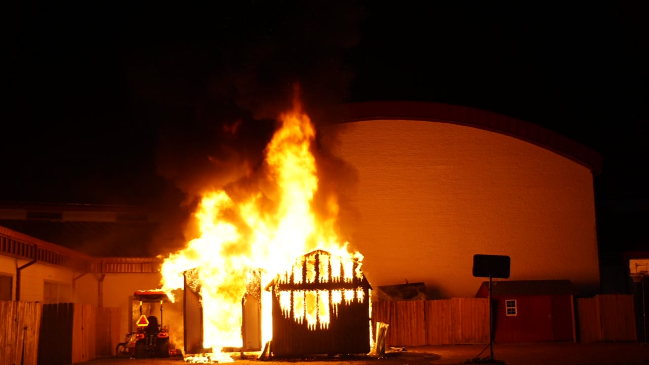 A charter school in Moore County is closed after the two storage sheds behind the school caught fire Tuesday night, officials said.