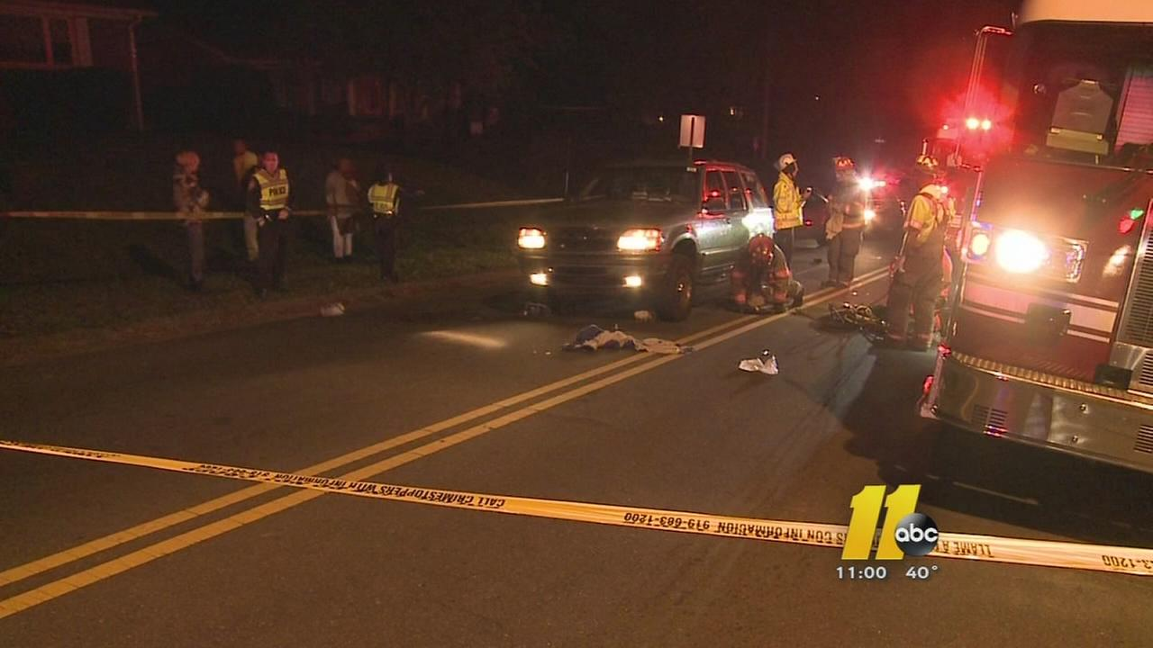 People trying to help a dog hit by car in Durham