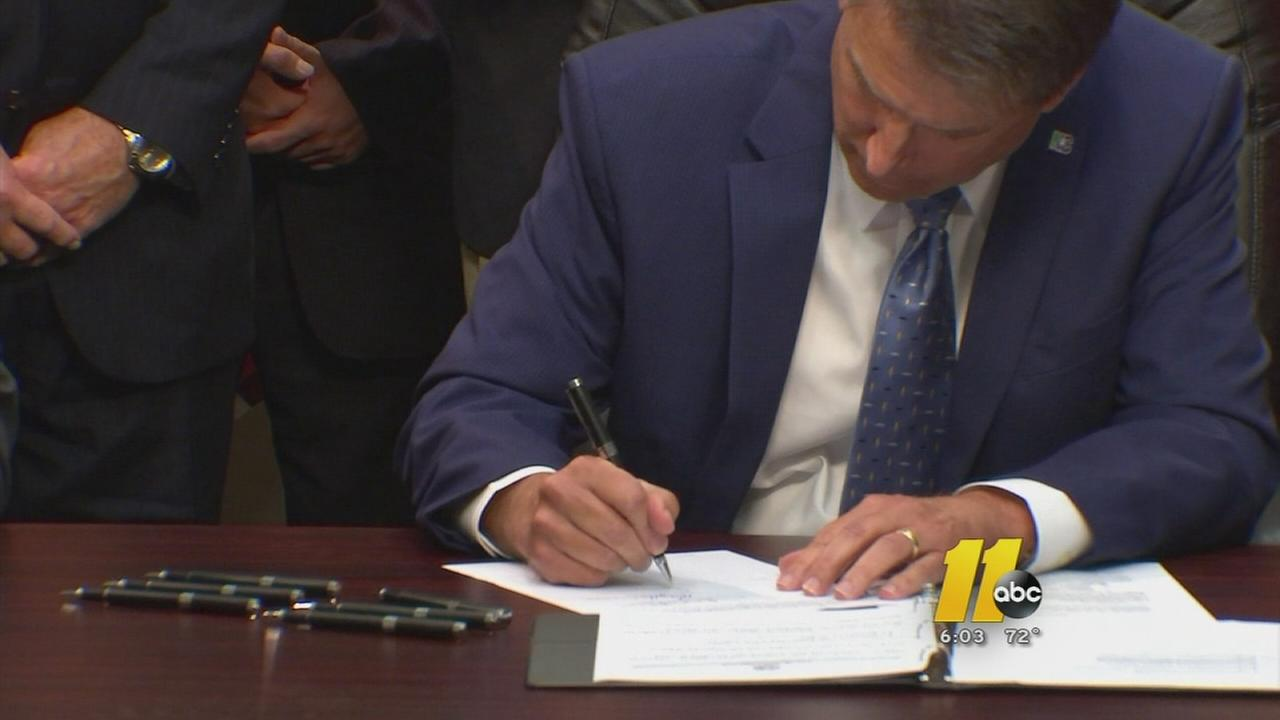 Governor Pat McCrory signs immigration bill into law