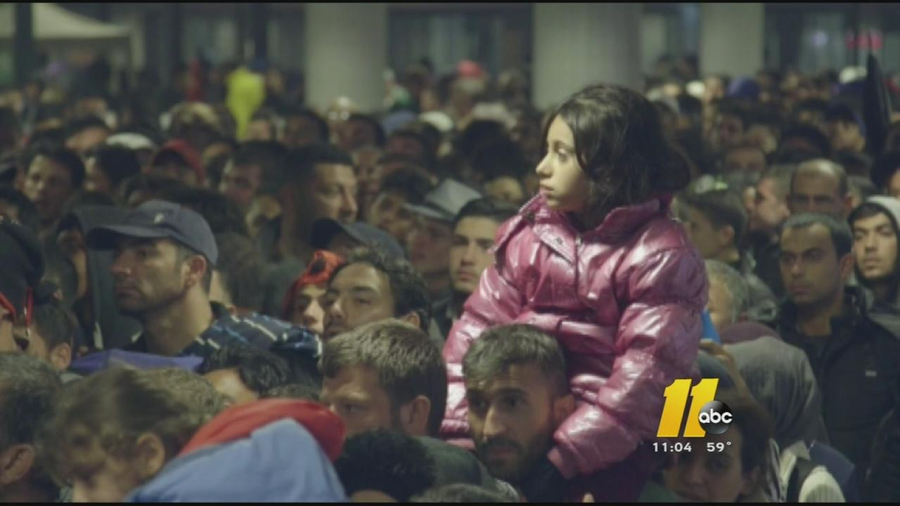White House tries to ease refugee concerns