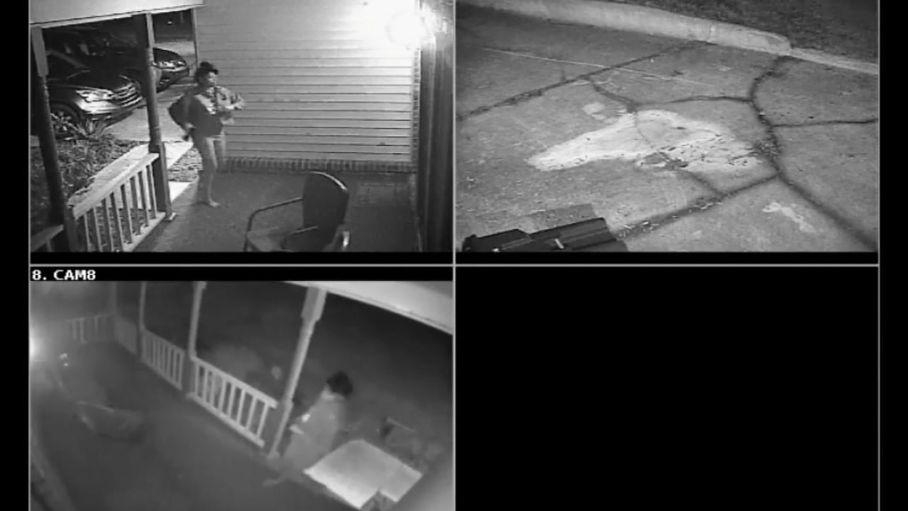 Women seen on surveillance video running up to a Durham home with a gun in her hand