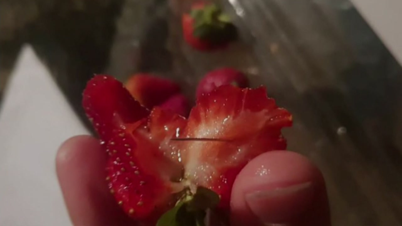 Woman accused of putting needles in strawberries across Australia