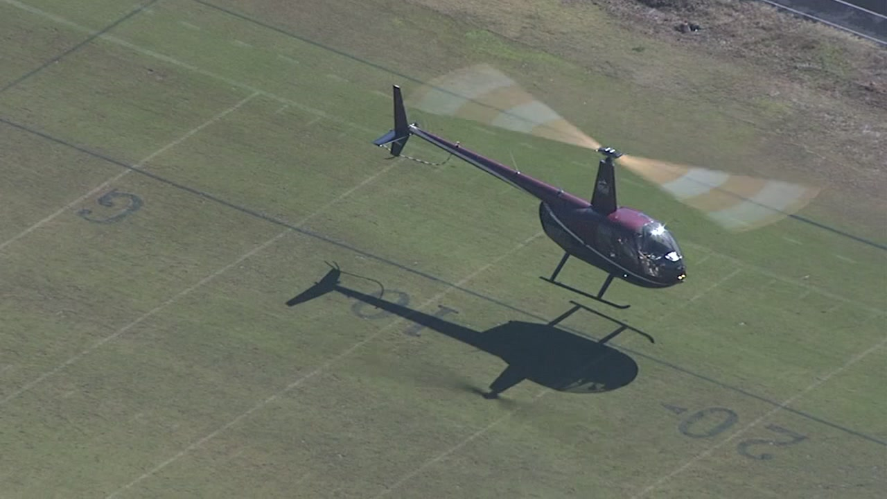 Helicopter helps dry football field at Jordan High School