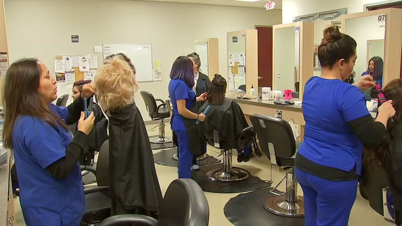 Cosmetology students carefully craft wigs for Duke cancer patients.