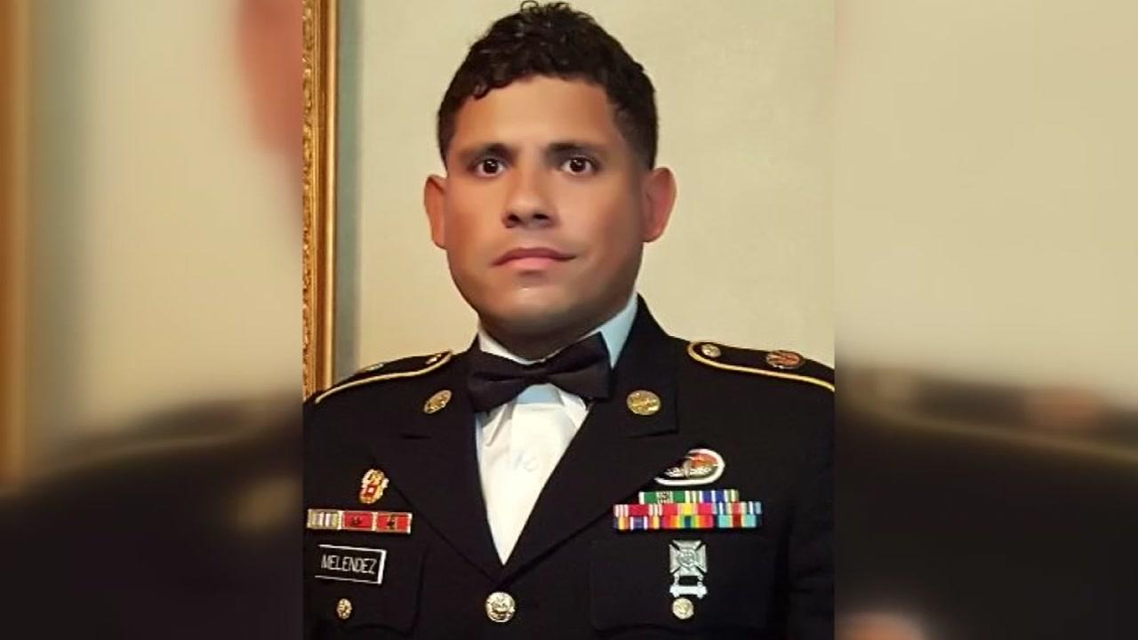 Vigil held for slain soldier.