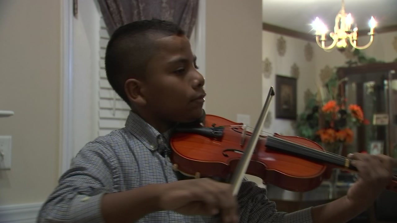 Tyler Butler-Figueroa, 11, is a violinist and cancer survivor who will play the national anthem at the Canes Hiockey Fights Cancer night.