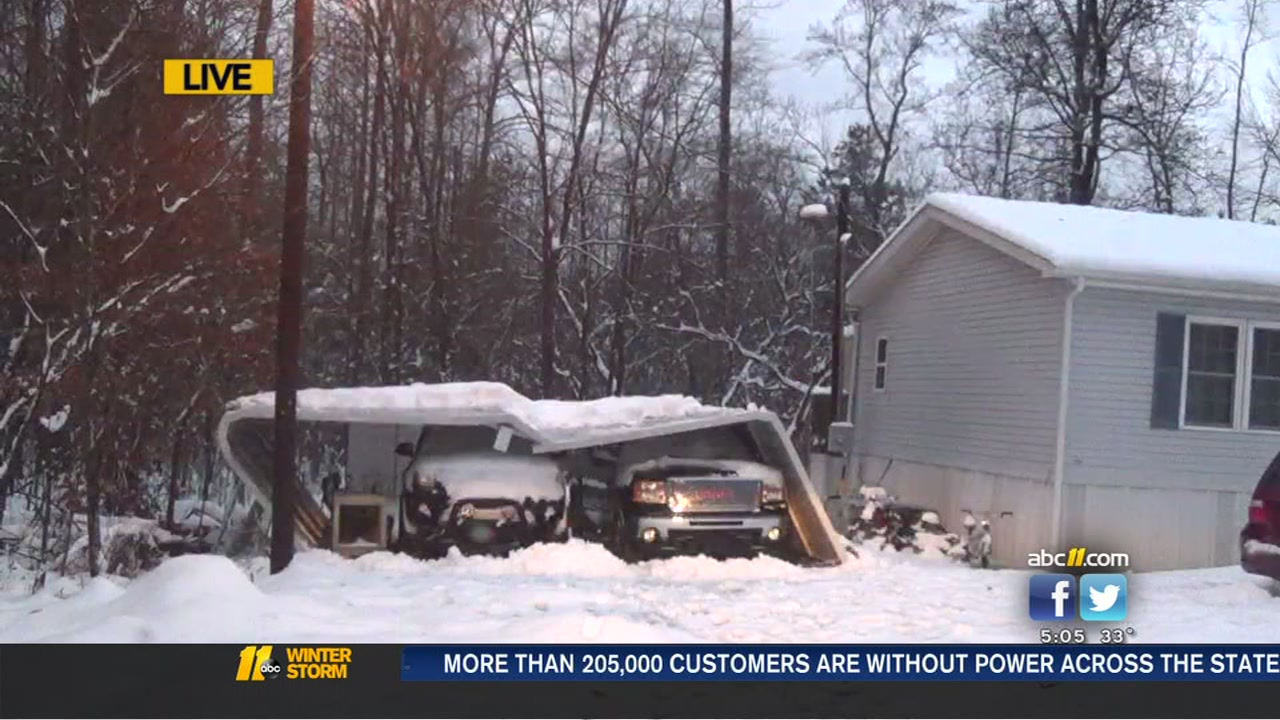 Carport in Orange County collapses under the weight of snow.
