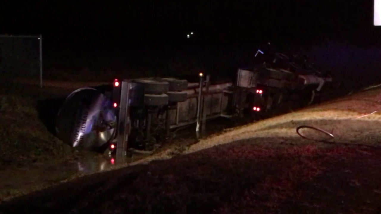 A tanker overturned after a crash that left six people hurt.