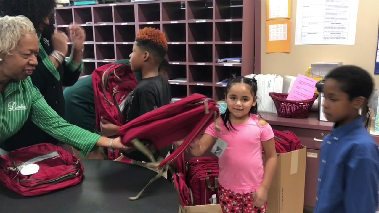 Burton students get new backpacks in a holiday giveaway.