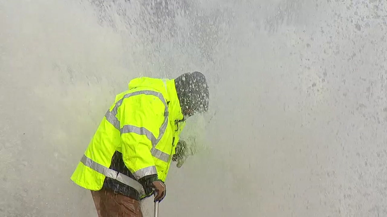 Just doing his job: Raleigh worker endures watery blast to turn off flow from missing hydrant.