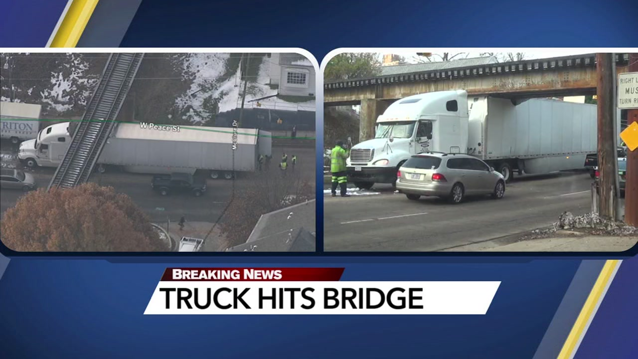 A tractor-trailer failed to heed the low clearance warning for a bridge on Peace Street in Raleigh.