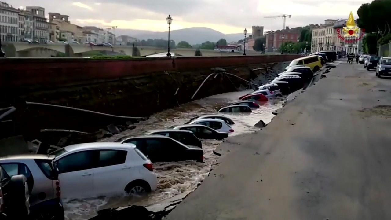 Cars sucked into lengthy sinkhole