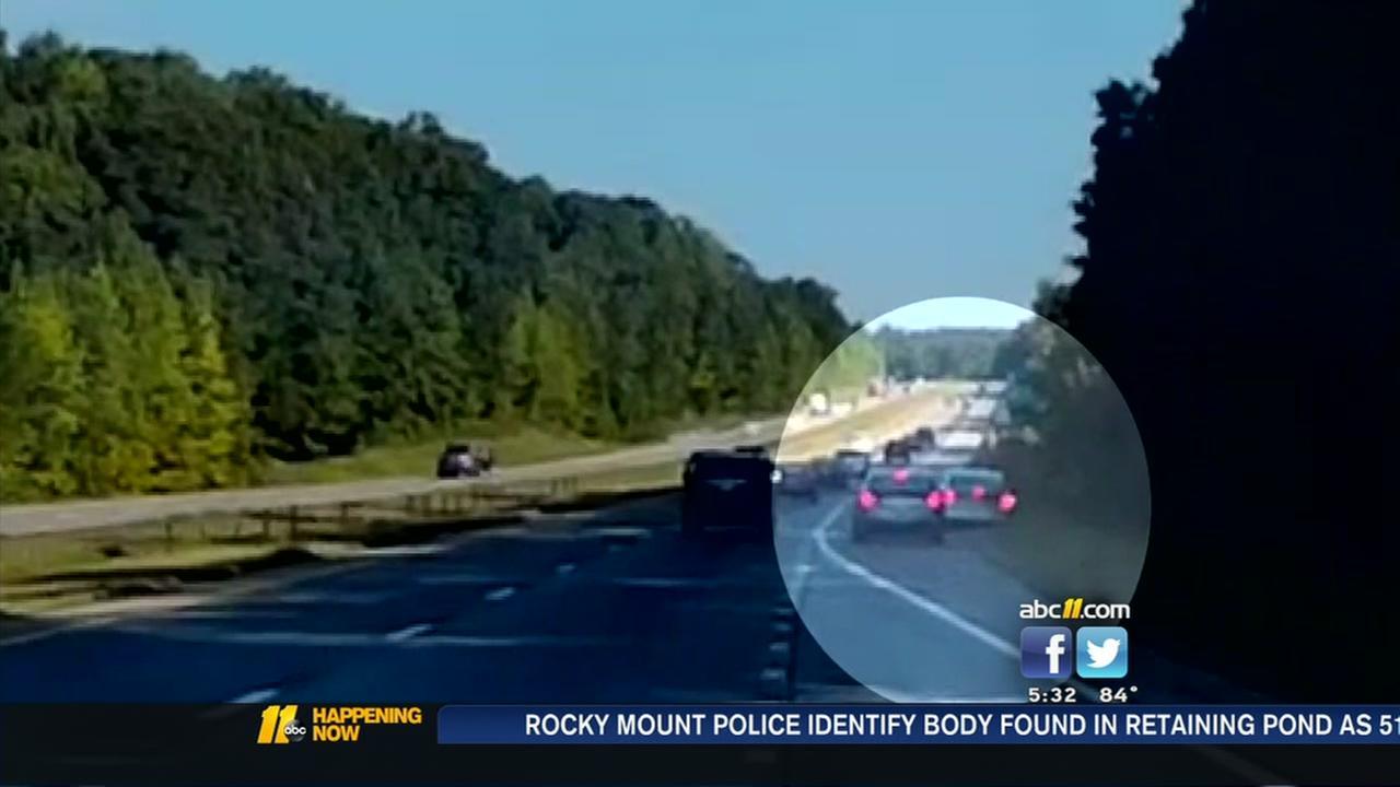 Dashcam video shows erratic driver swerving, speeding on I-40