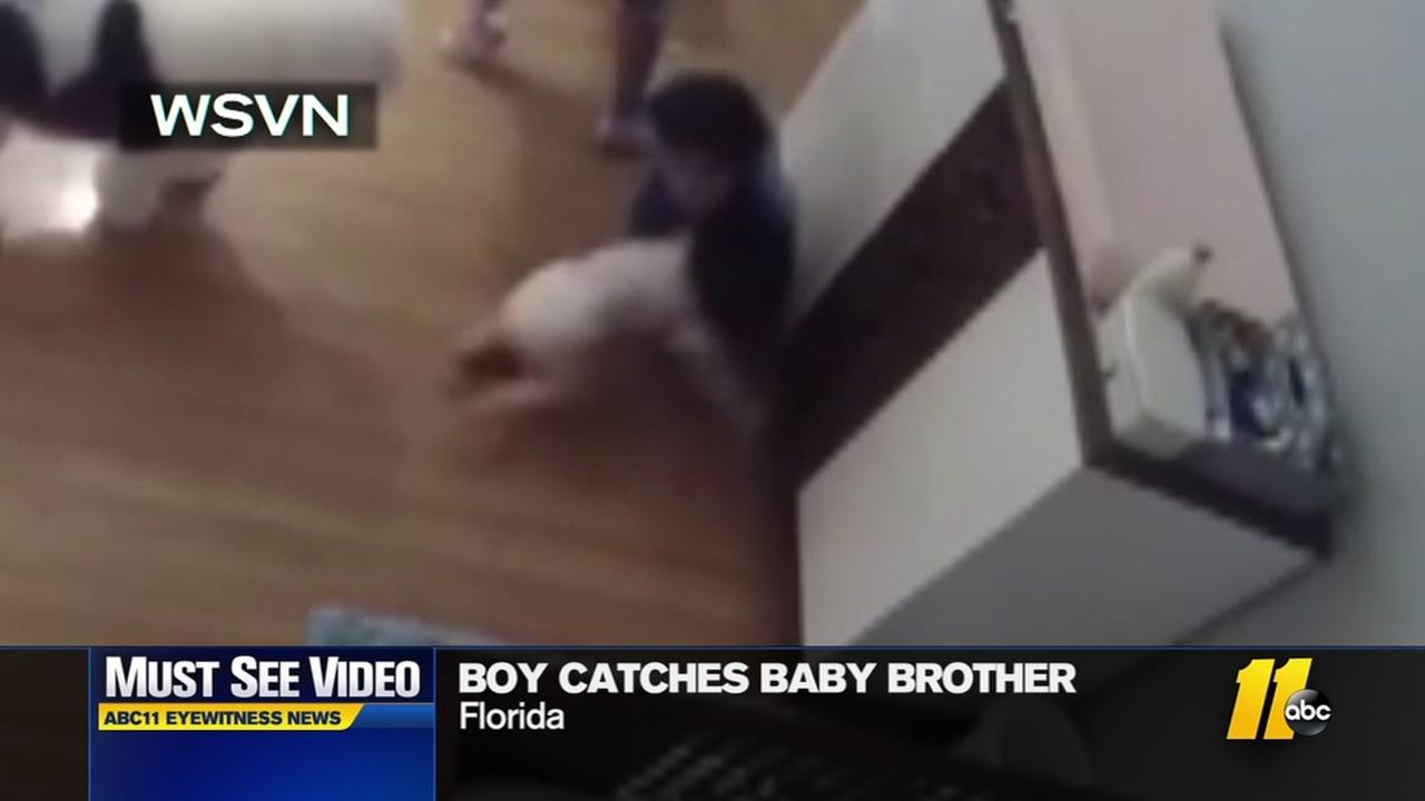 Boy catches baby brother as he falls from table