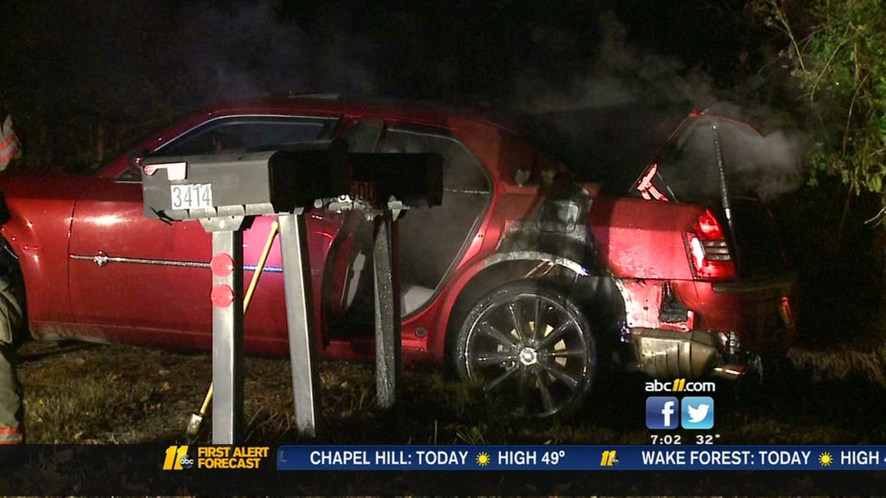 Man rescued from burning car