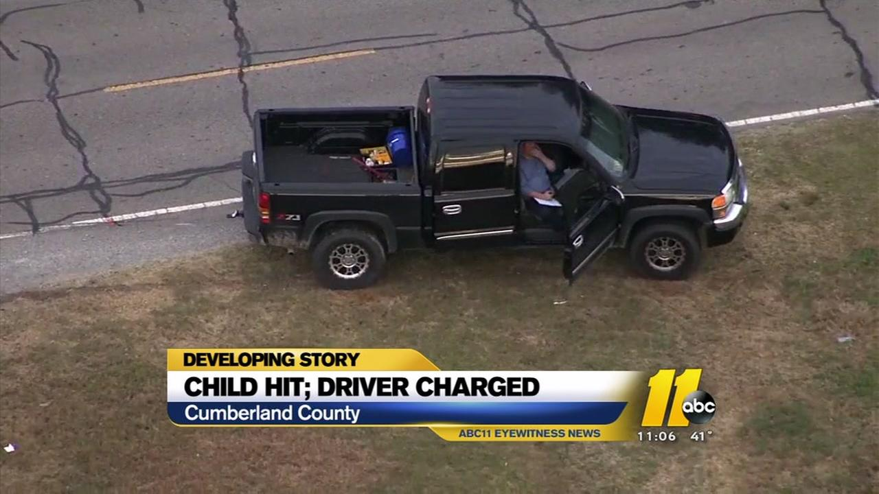 Child getting off school bus hit by truck