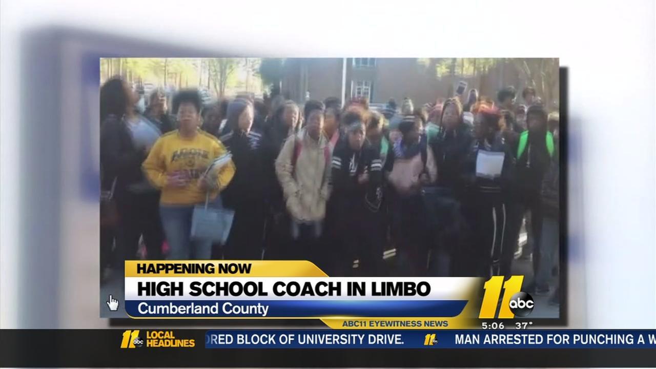 HIgh school coach in limbo