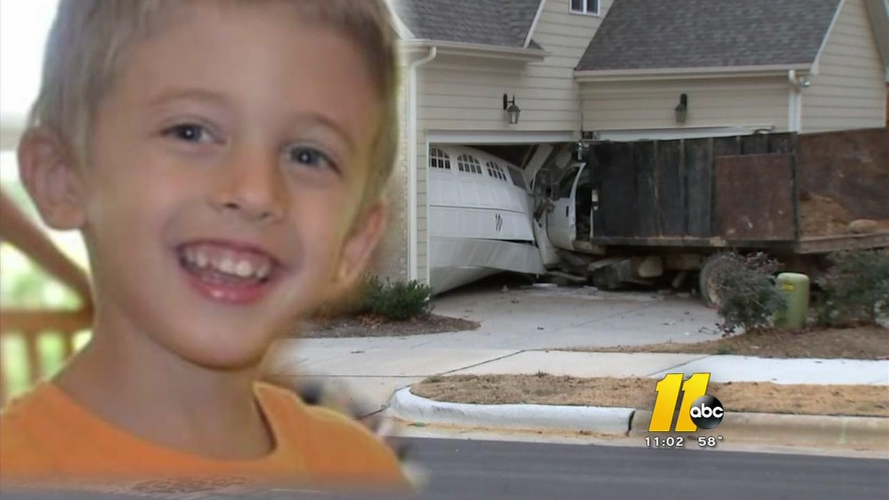 Man charged after runaway truck kills boy