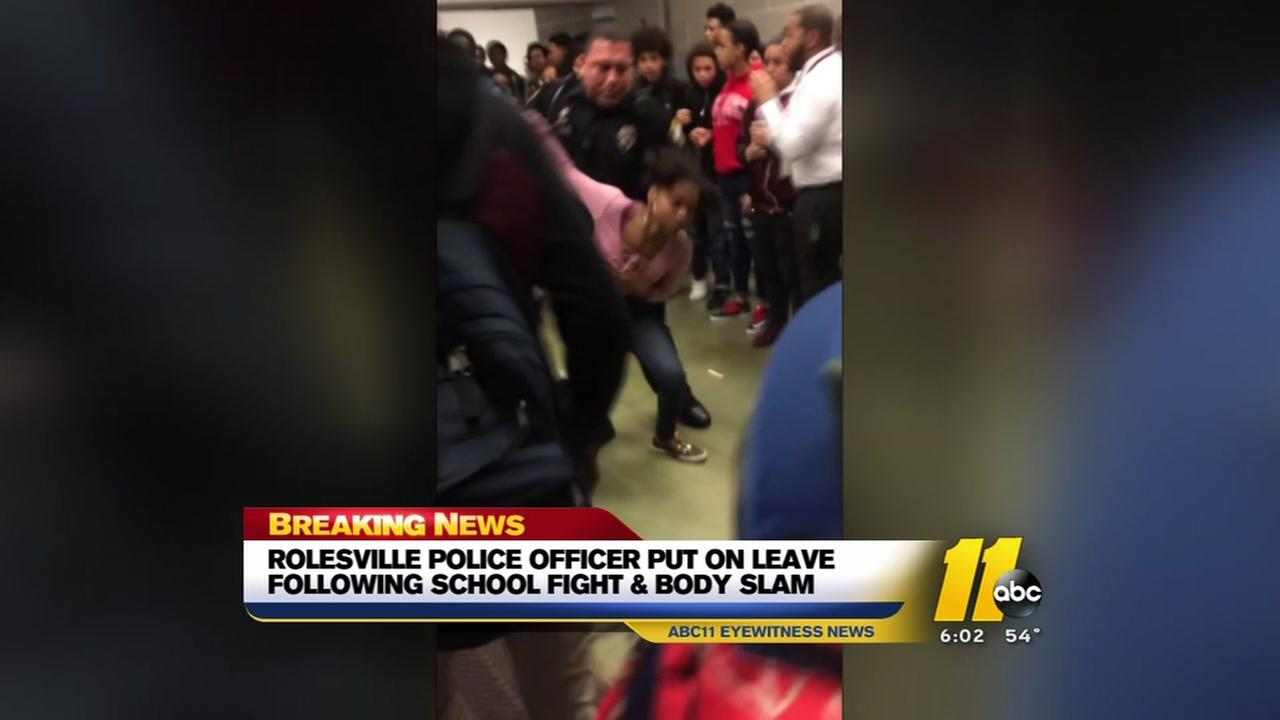 Officer put on leave after school fight and body slam