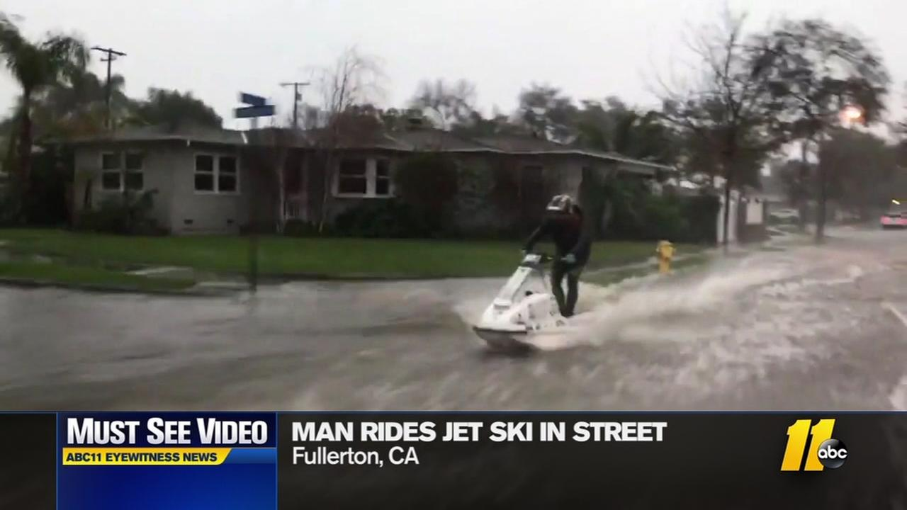 California man rides Jet Ski through flooded streets