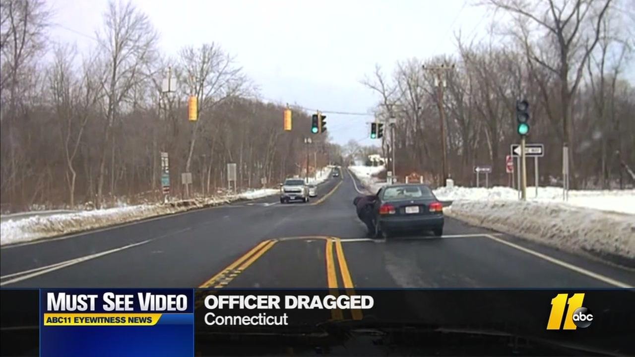 Officer dragged