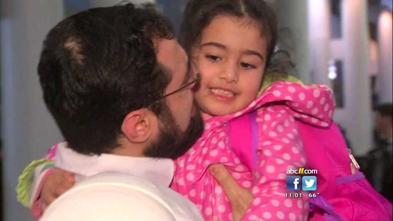 A joyful reunion for a Syrian family with their 4-year-old daughter